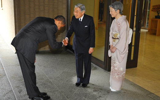 [Barry bows to Akihito]